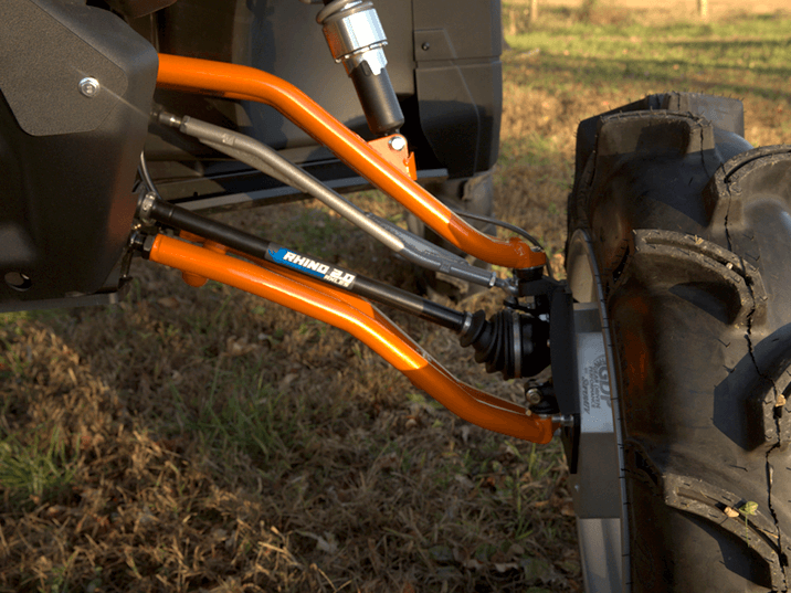 Closeup view of UTV with orange tubed SuperATV A-arms installed