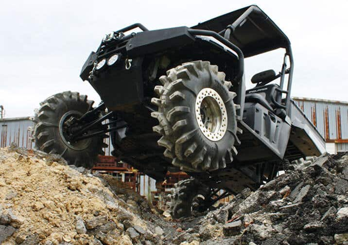 Closeup of black Ranger UTV with front tire in air
