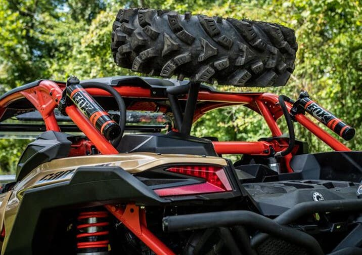 Closeup of UTV with a SuperATV spare tire carrier installed