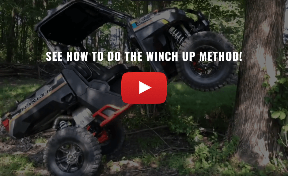 Image of a UTV being lifted using the winch up method