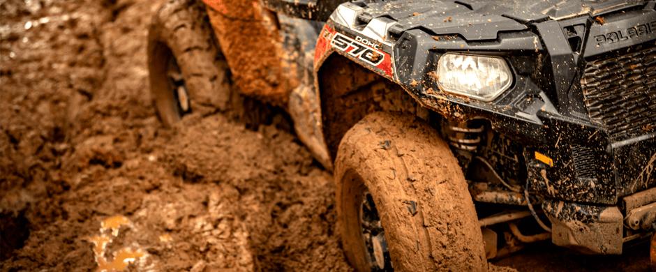 Closeup of UTV stuck in the mud.