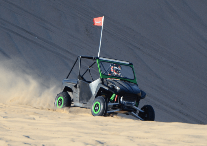 A UTV about to get stuck in the sand