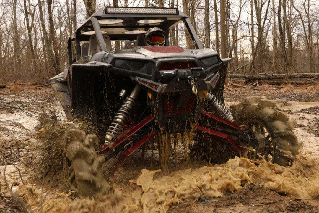 SuperATV's Depth Finder with X300 axles tearing through the mud