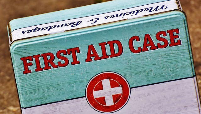 Blue and white first aid kit in metal box